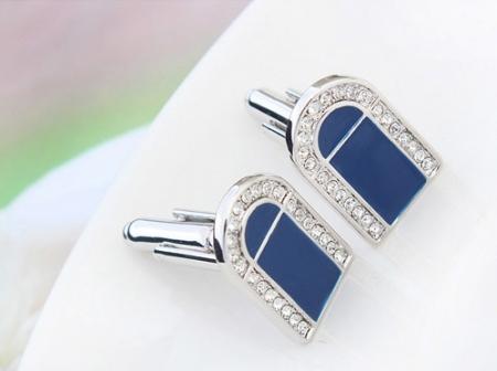 Butoni dark blue cu cristale, placati cu aur, garantie 6 luni
