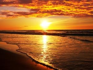 Fototapet Apus de Soare peste Mare0